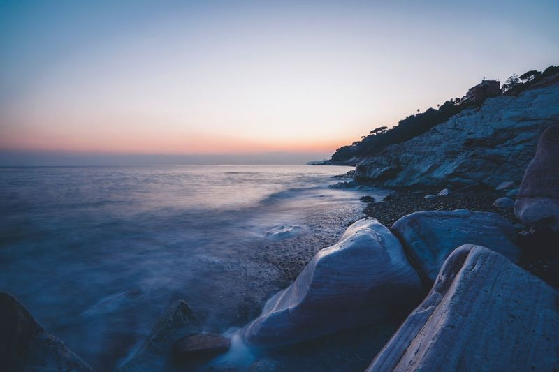 Cogoleto Liguria,Italy Sky Sea Water Scenics - Nature Beauty In Nature Beach Sunset Non-urban Scene Rock Idyllic Clear Sky Tranquil Scene Nature Horizon Over Water Tranquility Land Rock - Object Horizon No People