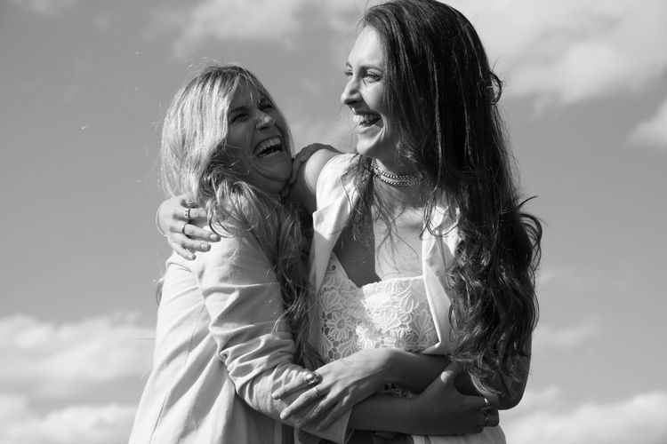 Togetherness Two People Emotion Bonding Women Young Adult Young Women Love Positive Emotion Adult Long Hair Females Smiling Standing Happiness People Hairstyle Sky Focus On Foreground Hair Daughter Outdoors Beautiful Woman