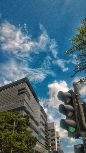 Simplicity Is Beauty. Relaxing Moments A Moment In Time Sky And Clouds Tree And Sky EyeEm Nature Lover Traffic Lights Traffic Lights View- What Do You See When You're Waiting ? Cloud Formations Architecture Details Buildings & Sky