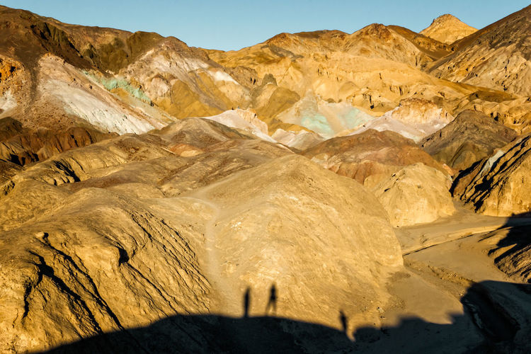 Scenic view on the artist drive in the death valley with shadows of visitors on the rocks