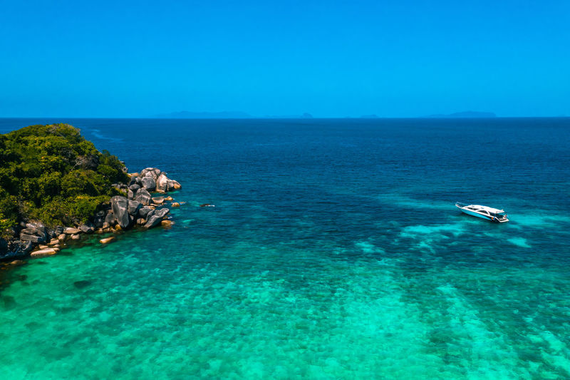 Aerial View of Boulder Island with Tourist boat, Myanmar Andaman Boulder Island Nga Khin Nyo Island Areal View Trip Tourist Boat Tourist Myanmar Burma Outdoors Turquoise Colored Clear Sky Nautical Vessel Day Nature Tranquility Tranquil Scene Sky Horizon Horizon Over Water Beauty In Nature Scenics - Nature Water Blue Sea