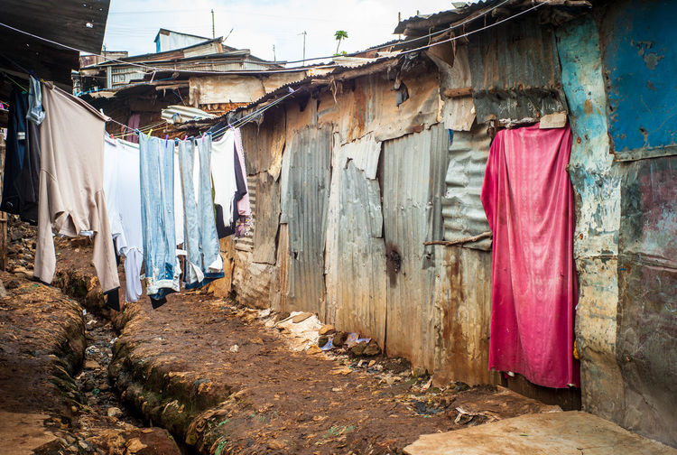 View Of Clothesline At Slums Against Sky