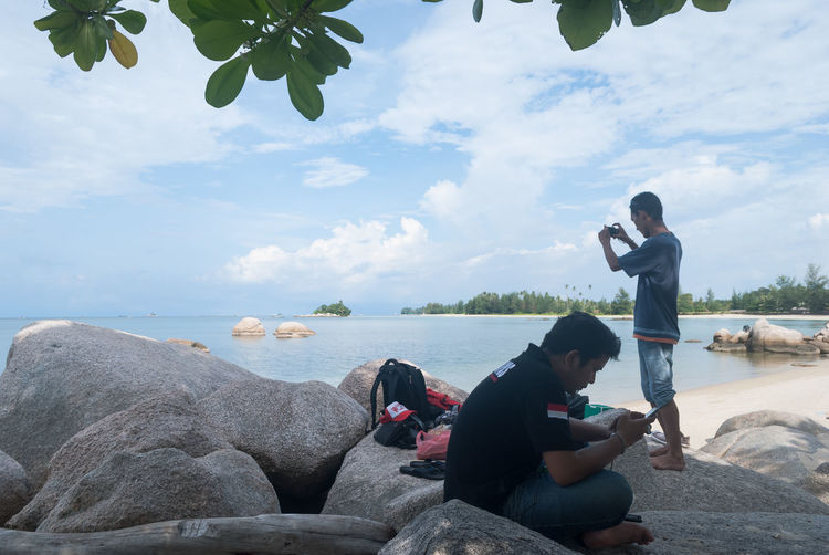 Gadgets Mans Beach Bintan  Bintan Island Bintanisland Casual Clothing Cloud - Sky Full Length Leisure Activity Nature Non-urban Scene Outdoors Person Relaxation Sea Sitting Sky Tourism Tranquil Scene Tranquility Trikorabeach Two Is Better Than One Vacations Water Weekend Activities