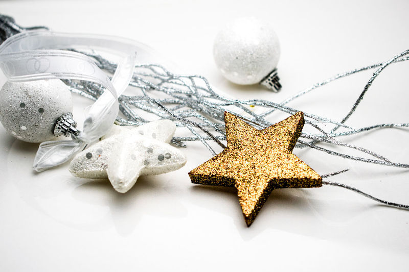 simple white, silver and gold Christmas background White Color White Christmas Golden Star Christmas Time Christmas Card Glitters Merry Christmas Christmas Background EyeEm Selects Star Shape Christmas Christmas Decoration Celebration Indoors  Christmas Ornament