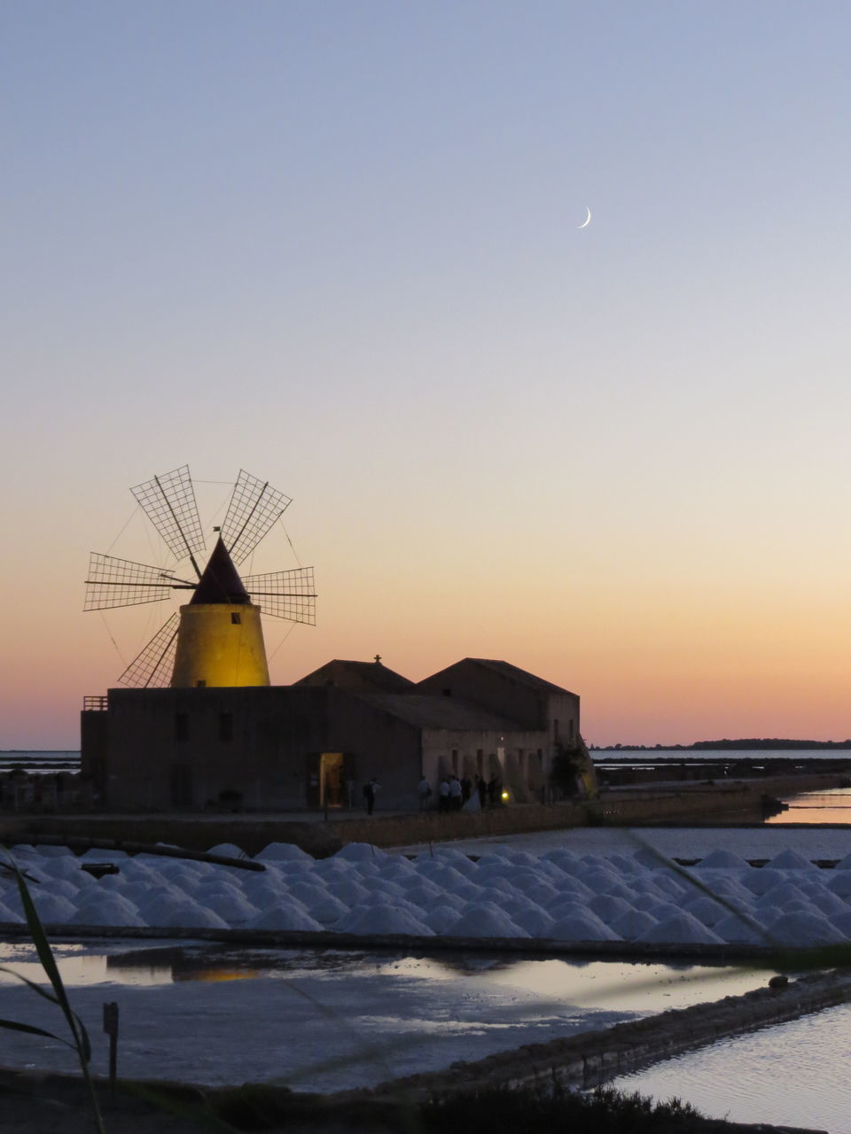 sunset, built structure, building exterior, cold temperature, architecture, sky, nature, no people, moon, clear sky, snow, outdoors, winter, beauty in nature, windmill, traditional windmill, astronomy, day