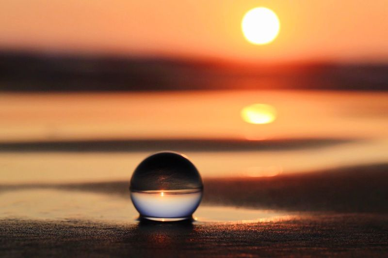 Sunset in a Glass Ball Sunset Glass Ball EyeEm Selects Sunset Sky Sphere Close-up Focus On Foreground Nature No People Reflection Crystal Ball Glass - Material Sun Selective Focus Orange Color Scenics - Nature Glass