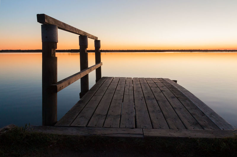 SMALL WOODEN JETTY AT SUNSET