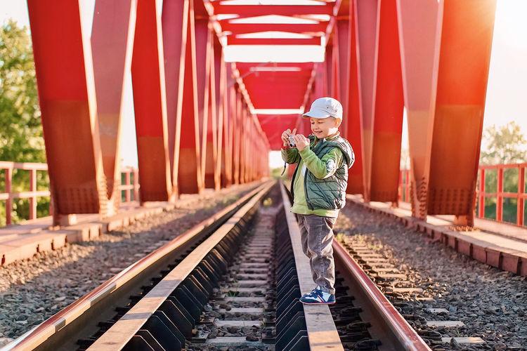 Man walking on railroad track