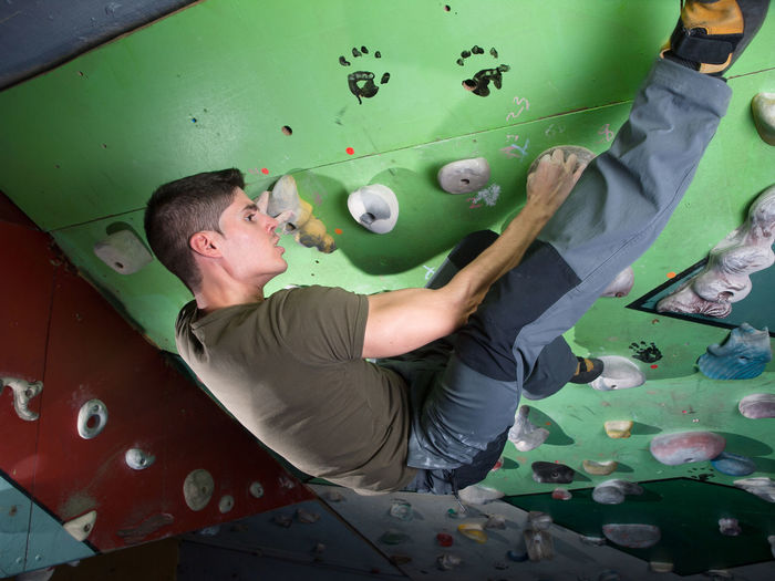Young Man On Climbing Wall