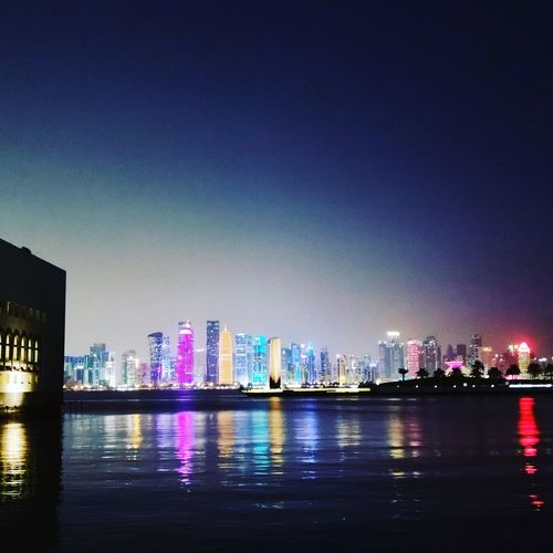 Night in Qatar to visit my brother, did not expected to be this beautiful here Doha,Qatar City Cityscape Urban Skyline Illuminated Water Modern Skyscraper Downtown District Financial District  Reflection Downtown Tourist Attraction  Skyline Infrastructure City Location Urban Scene