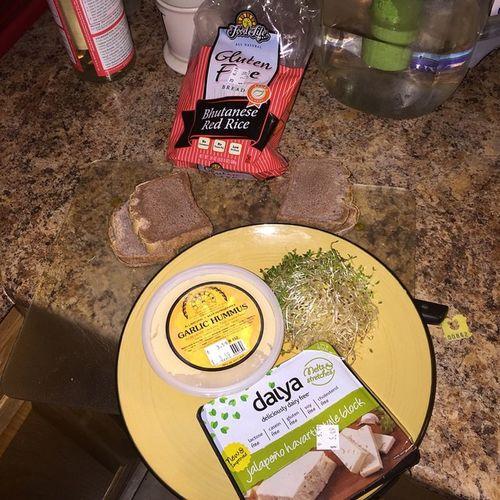 Dinner is a simple affair tonight Thesproutman Alfalfasprouts @foodforlifebaking Glutenfreebread bhutaneseredrice garlichummus from sunneenhealthfoods sunneen and @daiyafoods deliciouslydairyfree vegancheese jalapenohavarti vegan whatveganseat gayvegan