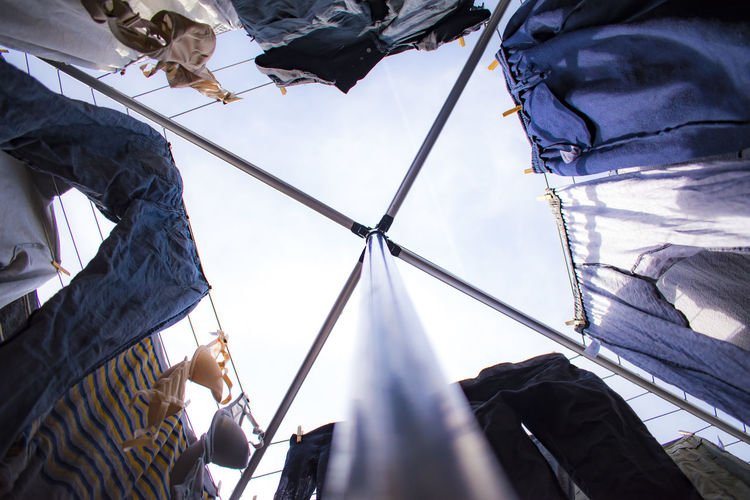 Low Angle View Of Laundry Drying On Rack Against Sky