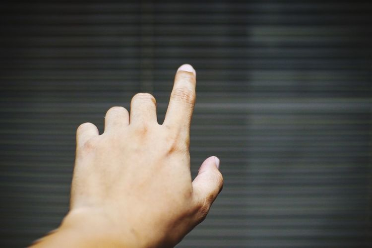 Cropped hand pointing outdoors