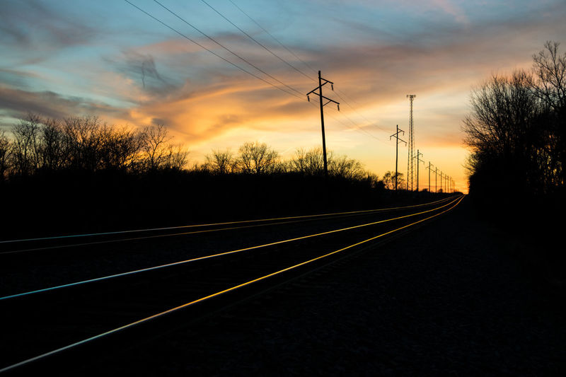 Its very soothing about the railroad track how the light came shining making it look like a long cable of light Evening Light Railroad Track Beauty In Nature Cable Cloud - Sky Day Electricity  Electricity Pylon Evening Nature No People Outdoors Rail Railroad Road Silhouette Sky Sunset Technology The Way Forward Trail Train Transportation Tree