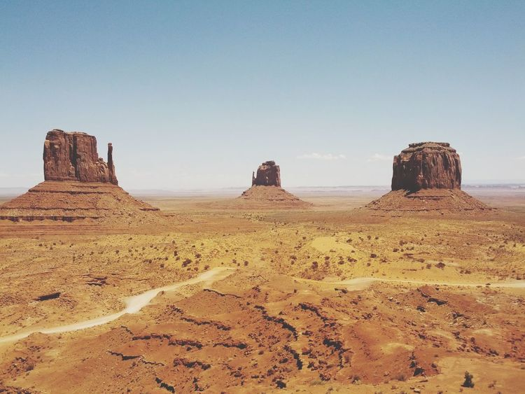 Monument Valley Summer Road Tripping Sand Dune Clear Sky Desert Arid Climate Ancient Civilization Sand History Rock - Object Ancient King - Royal Person Arid Landscape Natural Landmark Canyon Sandstone