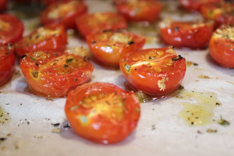 Close-Up Of Olive Oil On Tomatoes At Table