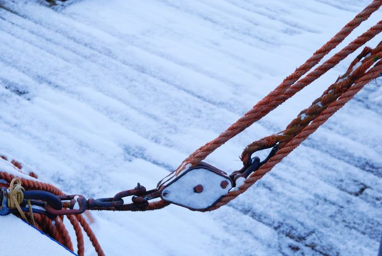 High angle view of pulley over snow covered footpath