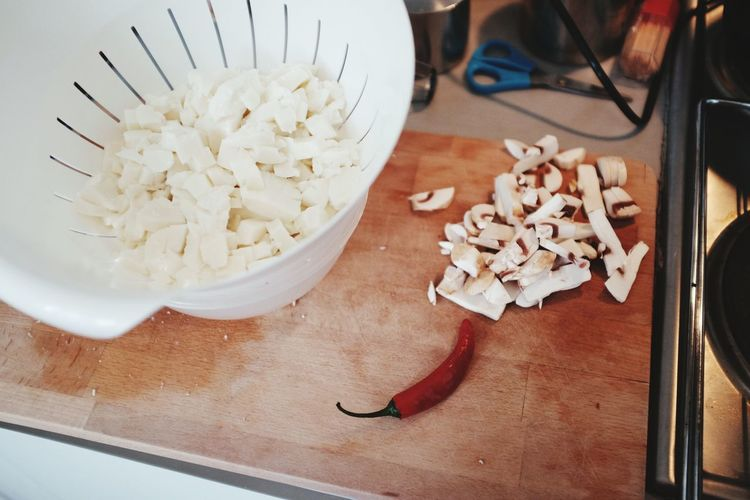 Chopped Mozzarella In Colander On Kitchen Counter