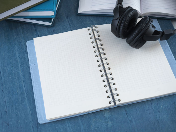 High angle view of book with headphones on table
