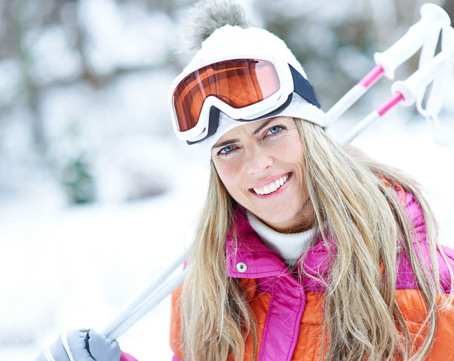 portrait of smiling woman in snow Active Carry Clothing Cold Temperature Cross-Country Skiing Day Emotion Females Forest Hairstyle Happiness Happy Headshot Holiday Leisure Leisure Activity Lifestyle Lifestyles Looking At Camera Nature On The Way One Person Outdoors Outside People Portrait Real People Ski Ski Goggles Ski Holiday Ski Poles Ski Trip Skier Skiing Smile Smiling Snow Sport Warm Clothing Winter Winter Holiday Winter Sports Woman Women Young Adult