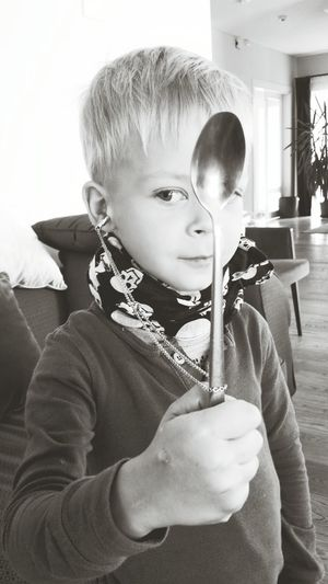 Boy Having Fun Spoon Blackandwhite that's how his imagination works. New way to wear my necklace :D