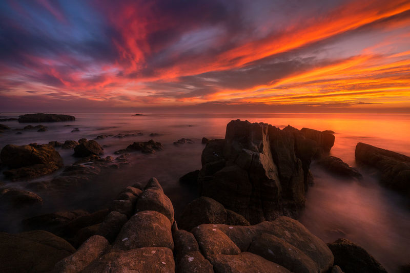 amakusa,kumamoto,japan Sky Sunset Rock Cloud - Sky Scenics - Nature Rock - Object Beauty In Nature Solid Sea Water Tranquility Tranquil Scene Nature Idyllic Long Exposure Dramatic Sky No People Orange Color Land Horizon Over Water Romantic Sky