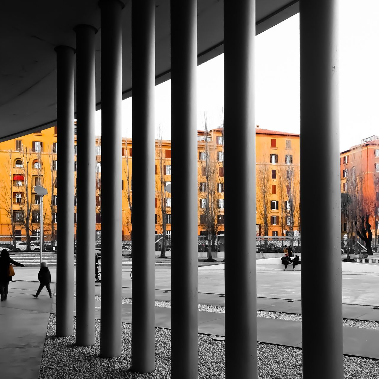architecture, built structure, building, architectural column, no people, building exterior, in a row, side by side, day, city, outdoors, metal, transportation, repetition, nature, sky, orange color, connection, travel destinations