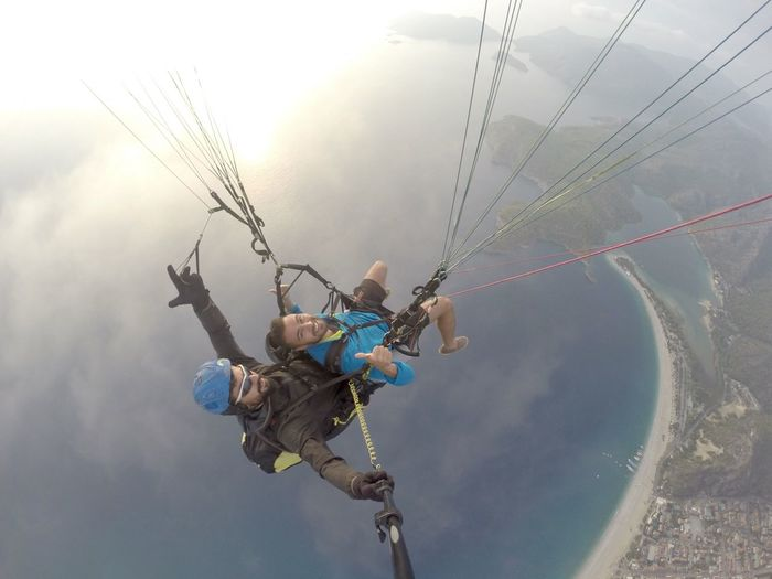 High angle view of friends parasailing