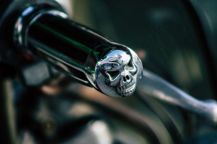 Close-up of motorcycle handlebar