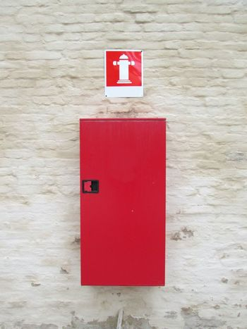 Red fire system box with sign Firefighter Fire Alarm Fire Extinguisher Hazard Co2 Burning Security Equipment Danger Wall