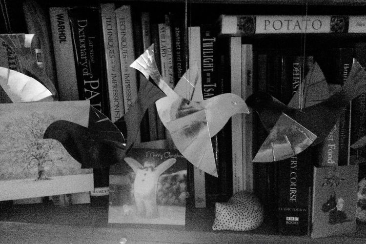 Christmas decorations shining paper doves in retro black and white Paper No People AMPt_community Eye4photography  Christmas Decoration Indoors  Change Your Perspective No People, Text Indoors  Day