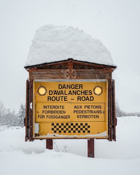 Information sign on snow covered field