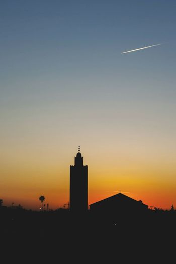 airplane and sunset Mosque Architecture Mosque Islam Morocco North Africa Marocco Middle East City Cityscape Sunset Skyscraper Clear Sky Silhouette Urban Skyline Sky Architecture Building Exterior Tower Tall - High Romantic Sky EyeEmNewHere Stories From The City