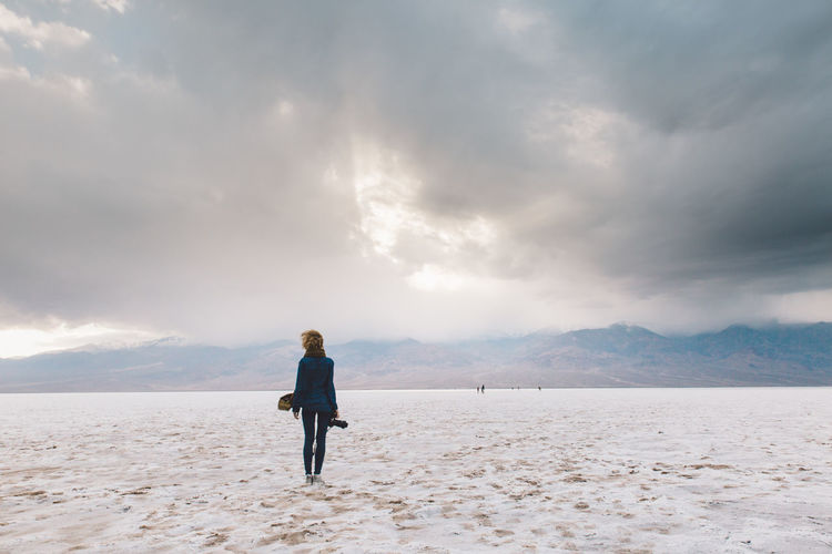 Arid Climate Arid Landscape Badwater Basin Cloud - Sky Curly Hair Day Death Valley Death Valley National Park Death Valley, California Desert Full Length Girl Hair In The Wind Mountain Nature Nature One Person Outdoors Sand Scenics Sky Standing Storm Valley Windy Lost In The Landscape California Dreamin