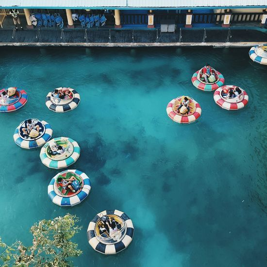 Water Blue Floating On Water Park People Float Boat Ride Colors Poker Chips A Bird's Eye View