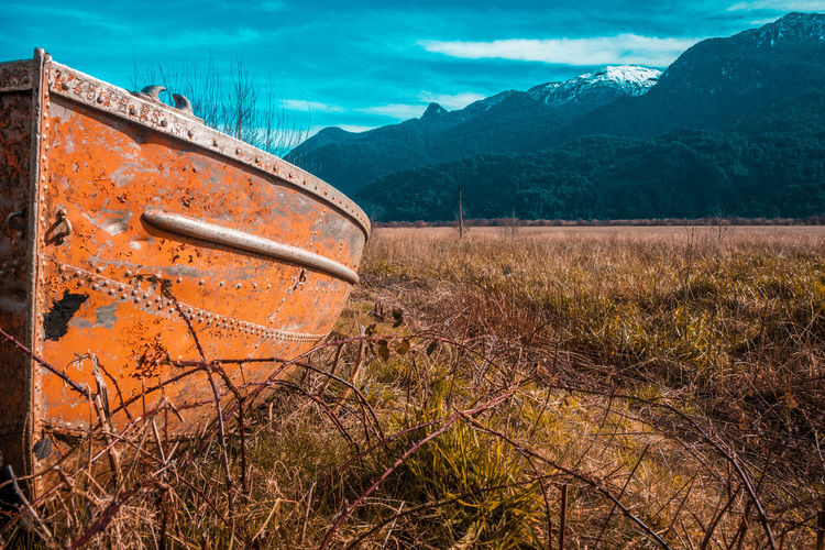 Abandonment... EyeEmNewHere The Great Outdoors - 2018 EyeEm Awards Abandoned Cloud - Sky Damaged Day Deterioration Field Grass Land Metal Mode Of Transportation Mountain Nature No People Non-urban Scene Outdoors Plant Rusty Scenics Scenics - Nature Sky Tranquility Transportation Tree