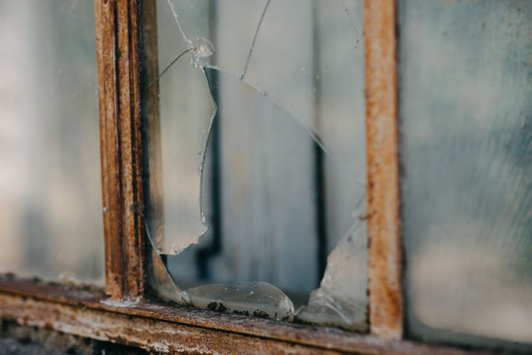 Close-up of broken window