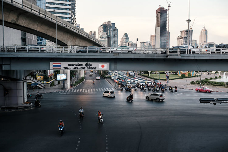 Thai-japanese friendship bridge at silom intersection area with heavy traffic at rush hour