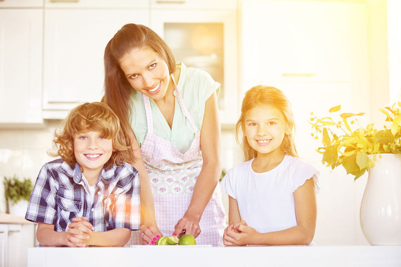 portrait of happy friends smiling At Home Bonding Boy Boys Breakfast Child Childhood Children Citrus Fruit Content Cutting Daughter Eat Emotion Everyday Life Family Females Food Fresh Freshness Fruit Fruit Salad Girl Groceries Happiness Happy Having Breakfast Health Healthy House Hunger Hungry Indoors  Inside Kids Kitchen Laughing Leisure Lemon Lifestyle Lifestyles Lime Looking At Camera Luck Mother Nutrition Parent People Portrait Positive Emotion Siblings Sister Smile Smiling Son Summer Together Togetherness Vitamins Woman Women Young Women