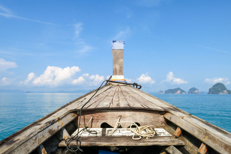 Long tail boat in the blue sea Architecture Beauty In Nature Blue Built Structure Cloud - Sky Day Mode Of Transportation Nature Nautical Vessel No People Outdoors Scenics - Nature Sea Sky Sunlight Transportation Travel Water Wood - Material EyeEmNewHere