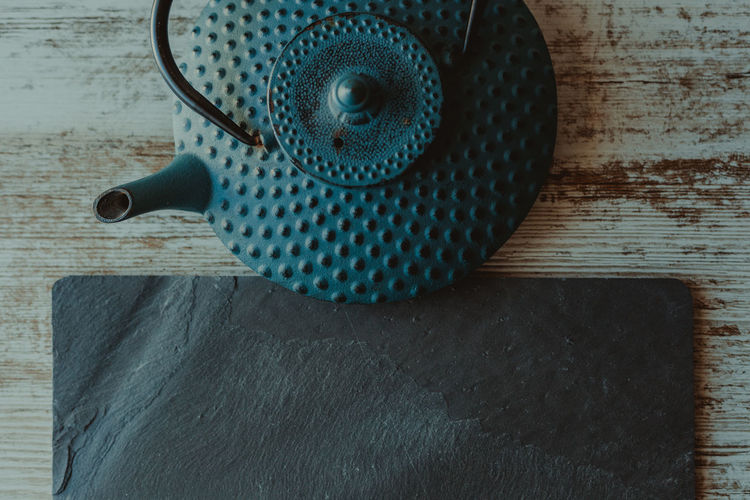 Tea Tea - Hot Drink Tea Time Tea Pot Teapot Infuser Iron Iron - Metal Kettle Blue Table Wood - Material Spotted Shape Household Equipment Close-up Still Life Pattern High Angle View No People Directly Above Flooring Metal Day Circle Indoors