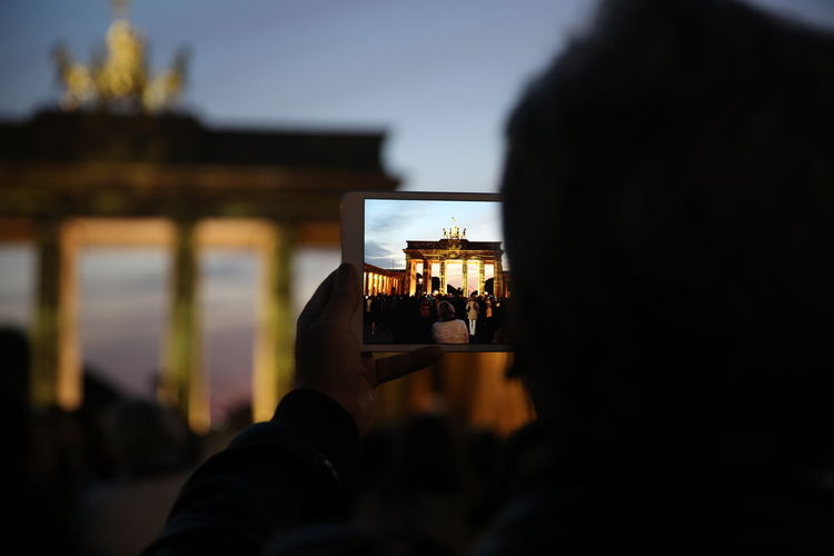 Adult Adults Only Berlin Brandenburger Tor Celebration Close-up Day Drink Human Body Part Human Hand Leisure Activity Lifestyles Men Mobile Outdoors Over The Shoulder View People Photography Themes Portable Information Device Rear View Selective Focus Sky Social Gathering Technology Togetherness