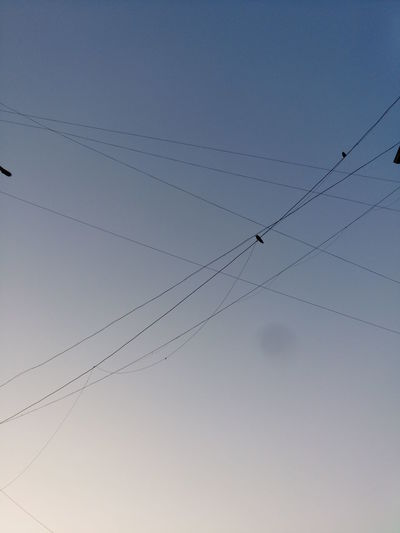 Low Angle View Of Cables Against Sky At Dusk