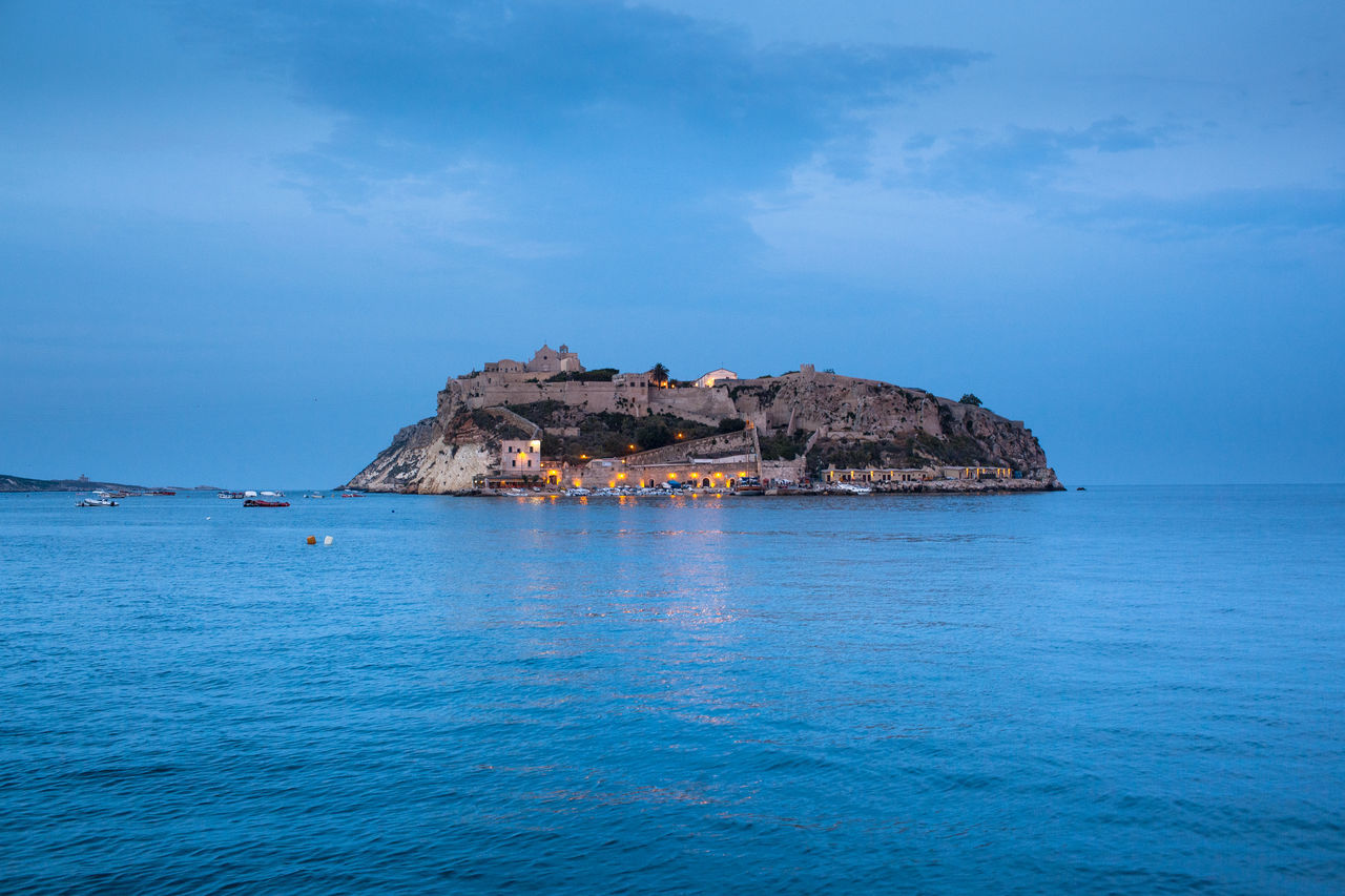 Scenic view of isole tremiti and sea against cloudy sky