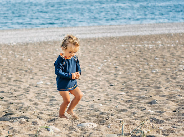 Lonely toddler girl walking on beach - Cirali, Antalya Province, Turkey Girl Girls Females Semi-dress Sun Protection Protection Toddler  Toddlerlife Caucasian Walking Lonely Mediterranean Sea Beach Life Life Is A Beach barefoot Copy Space Carefree Blond Hair Hairstyle Solitude Semi-nude Vacations Happiness Confidence  UV  Beach Land Child Childhood Full Length Sand Sea One Person Water Boys Casual Clothing Leisure Activity Nature Day Males  Real People Cute Men Innocence Hair Outdoors