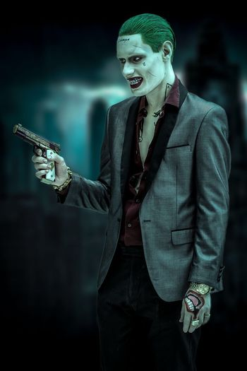 Katsucon 2019 - Joker The Joker Joker Cosplayer Cosplay Katsucon 2019 Katsucon Three Quarter Length Gun Well-dressed Weapon Smiling Young Adult One Person Suit Business Holding Standing Focus On Foreground