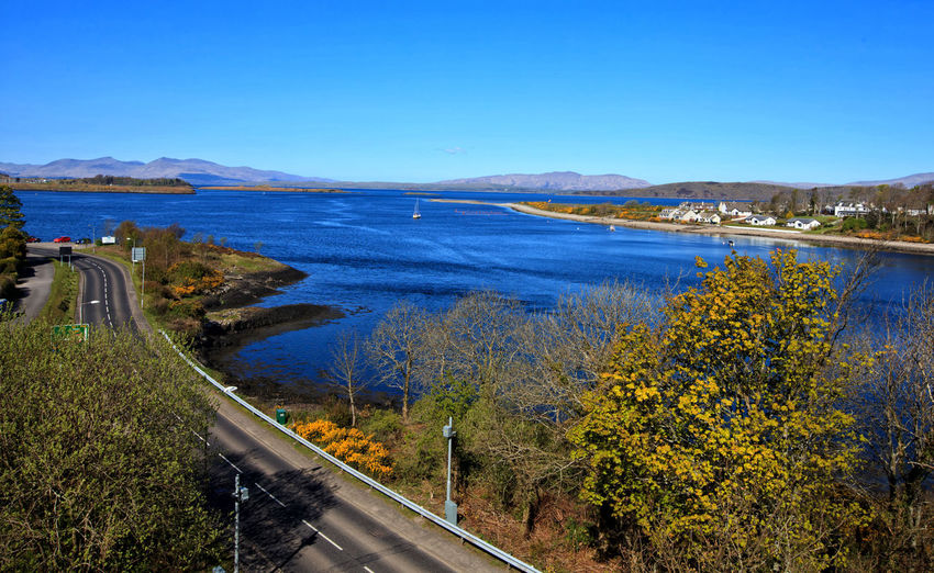 Loch Etive and Connel Village, view from above. Scotland, UK Beauty In Nature Blue Clear Sky Connel Village Day Etive Lake Lake View Loch Etive Mountain Nature No People Outdoors Road Rural Scenics Scotland Scottish Highlands Sea Sky Transportation Tree Uk Water Winding Road