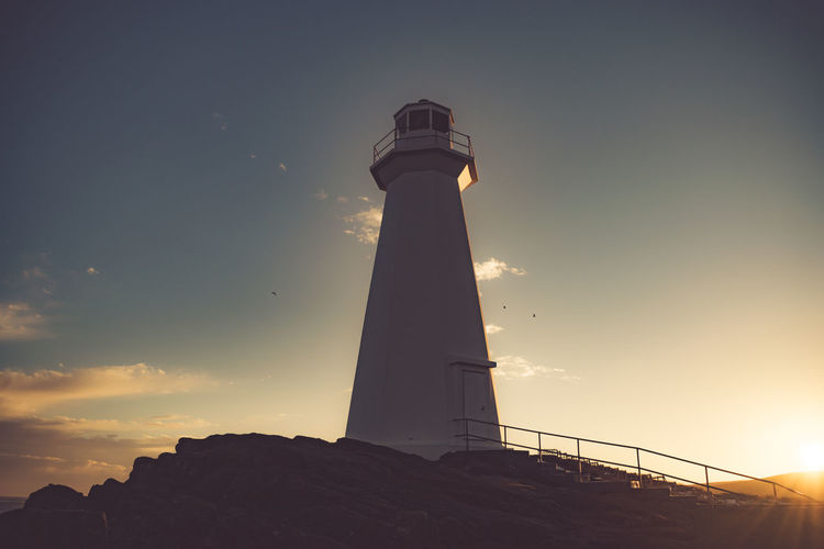 Beautiful sunset glow highlighting Cape Spear's lighthouse. Canada Cape Spear Dusk East Coast Golden Glow Landscape Lighthouse National Historic Site Nature Outdoors Sky St. John's, NL Sunset Travel Destinations