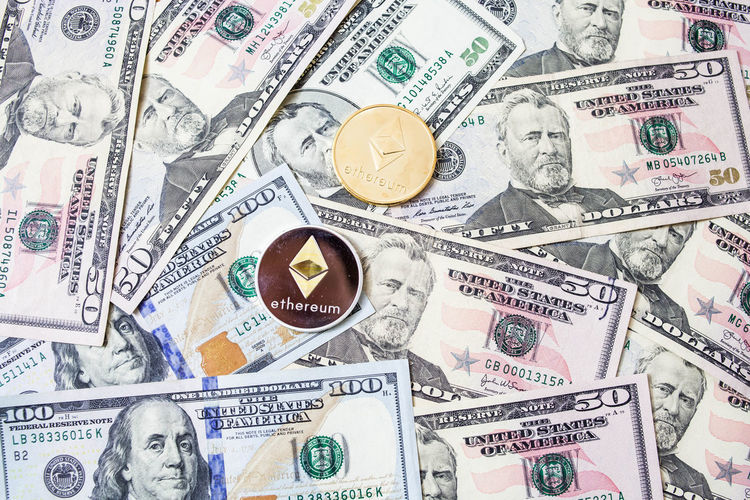 Ethereum with isolated US dollar background Backgrounds Business Currency Dollar Sign Ethereum Ethereum Classic Ethereum Classics Ethereum Miner Ethereum Mining Finance Full Frame Human Representation Indoors  Large Group Of Objects Male Likeness No People Paper Currency Representation Wealth
