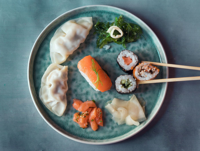 Variety of sushi on a plate Food Food And Drink Bowl Healthy Eating Directly Above Seafood Indoors  Asian Food Ready-to-eat Wellbeing Freshness No People Chopsticks Close-up Still Life Table Japanese Food Serving Size High Angle View Kitchen Utensil Chinese Food Garnish Sushi Sashimi  Seefood